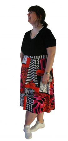Americano til hende med hofter og bred om lårene Den klassiske pærefirgur